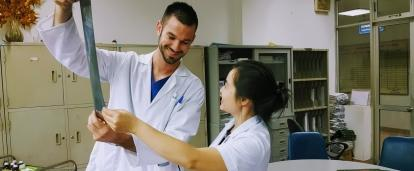 A Projects Abroad Medicine intern listens as a doctor explains the results of an x-ray at a hospital in Vietnam.